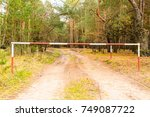 barrier to enter the forest.... | Shutterstock . vector #749087722