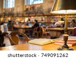 book on wooden table in reading ... | Shutterstock . vector #749091262
