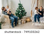 young happy family of four near ... | Shutterstock . vector #749103262