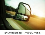 Small photo of Vehicle Blind Spot Assistance in the Side Mirror of Pickup Truck.