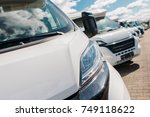 Brand New RV Campers For Sale. Recreation Vehicles Dealership Lot. - stock photo