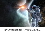 spaceman and his mission. mixed ... | Shutterstock . vector #749125762
