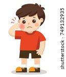 a little boy suffering from... | Shutterstock .eps vector #749132935