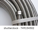 stainless corrugated tube.... | Shutterstock . vector #749154502