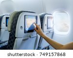 traveling airplane and using... | Shutterstock . vector #749157868