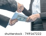 businessmen making handshake... | Shutterstock . vector #749167222