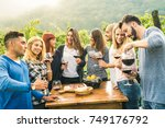 group of happy friends having... | Shutterstock . vector #749176792