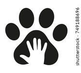 hand in the dog's paw on a... | Shutterstock . vector #749188696