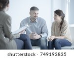 Small photo of Marriage trying to reconcile while talking to each other during marriage therapy with mediator