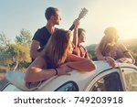 group of happy people in a car... | Shutterstock . vector #749203918