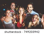 group of people having a party  ... | Shutterstock . vector #749203942