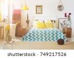 blue patterned bedding on king... | Shutterstock . vector #749217526