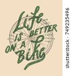 bicycle wheel shirt print. life ... | Shutterstock .eps vector #749235496