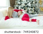 a woman with a child on... | Shutterstock . vector #749240872