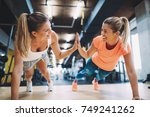 two sporty girls doing push ups ... | Shutterstock . vector #749241262