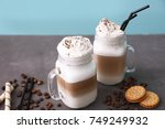 mason jars with latte macchiato ... | Shutterstock . vector #749249932