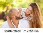 smiling young woman and young... | Shutterstock . vector #749255356