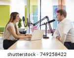 young woman interviewing a... | Shutterstock . vector #749258422