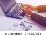 business man using smart phone... | Shutterstock . vector #749267056