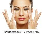 young women applied concealer... | Shutterstock . vector #749267782