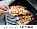 close up male hand touches... | Shutterstock . vector #749268742