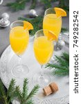 mimosa festive drink for... | Shutterstock . vector #749282542