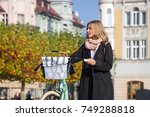 woman with vintage bike in the... | Shutterstock . vector #749288818