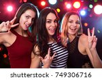 happy girls fun posing at a... | Shutterstock . vector #749306716