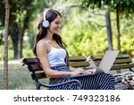 young beautiful girl sitting at ... | Shutterstock . vector #749323186