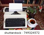 poet. a typewriter  tea and a... | Shutterstock . vector #749324572