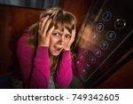 shocked woman with... | Shutterstock . vector #749342605