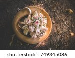 wedding bouquet in straw hat.... | Shutterstock . vector #749345086