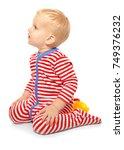 cute little baby in romper suit ...   Shutterstock . vector #749376232