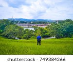 Small photo of Landscape of a man standing in the grass and look forward