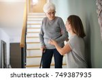 homecare helping elderly woman... | Shutterstock . vector #749387935
