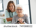nurse visiting old woman at home   Shutterstock . vector #749388022