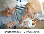 little girl having tea time... | Shutterstock . vector #749388046