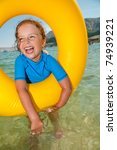 Happy summer vacation - little girl playing in the sea - stock photo