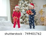 children in christmas | Shutterstock . vector #749401762