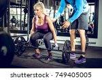 attractive blonde woman doing... | Shutterstock . vector #749405005
