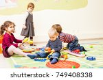 three kids playing with toys | Shutterstock . vector #749408338