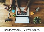 top view of two coworkers... | Shutterstock . vector #749409076