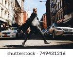 woman in a coat runs across the ... | Shutterstock . vector #749431216