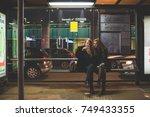 two young women outdoor bus... | Shutterstock . vector #749433355