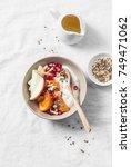 full fruit and greek yogurt...   Shutterstock . vector #749471062