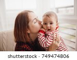 woman with red hair kisses... | Shutterstock . vector #749474806