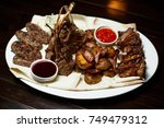 mix meat on the grill   meat... | Shutterstock . vector #749479312