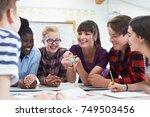 teenage students with teacher... | Shutterstock . vector #749503456