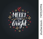merry and bright lettering on... | Shutterstock .eps vector #749524996