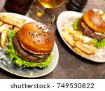 burgers with fries | Shutterstock . vector #749530822
